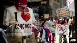 Demonstrators are reflected in a souvenir shop window in Chicago, Illinois, as peace activists march through the street demanding an end to NATO violence ahead of the summit.