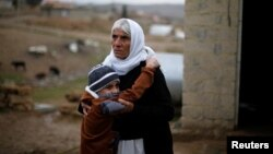 Iraq -- Ayman, a boy from a minority Yazidi community, who was sold by Islamic State militants to a Muslim couple in Mosul, hugs his grandmother after he was returned to his Yazidi family, in Duhok, Iraq, January 31, 2017