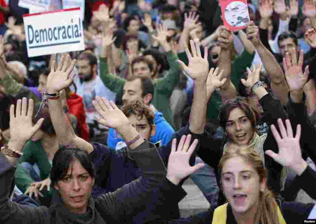 Spanish antiausterity protesters shout slogans during a demonstration outside Madrid's Parliament on September 26. (REUTERS/Susana Vera)