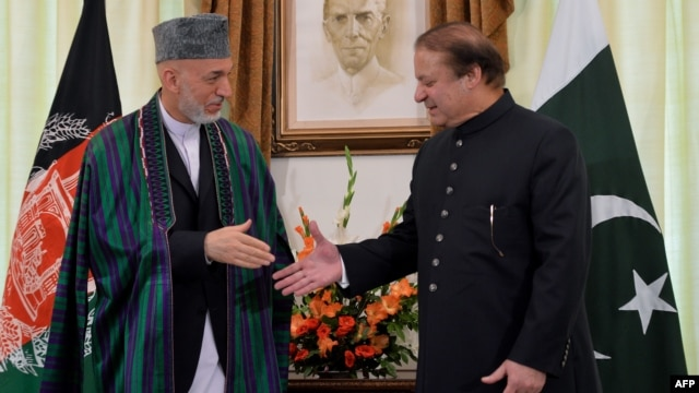 Afghan President Hamid Karzai (left) with Pakistani Prime Minister Nawaz Sharif at the Prime Ministers House in Islamabad in late August.