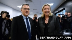 Aymeric Chauprade (left) with far-right French politician Marine Le Pen in 2014.