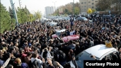 Mourners pay their respects to Morteza Pashaei outside the Tehran hospital where he died on November 14. The last time Iranians took to the streets spontaneously in such large numbers was following the disputed 2009 presidential election.