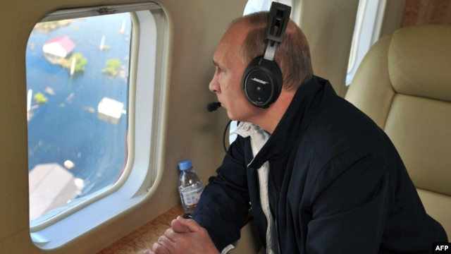 Russian President Vladimir Putin inspects a flooded area from a helicopter flying in the country's far eastern Amur region on August 29.