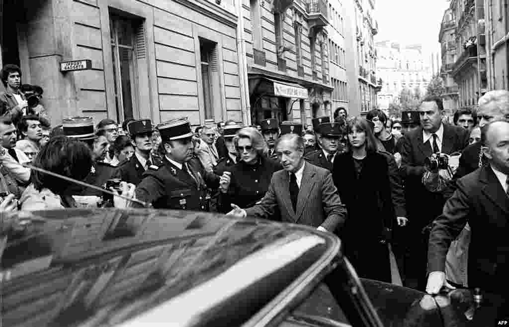 Italian baritone Tito Gobbi (center), Princess Grace of Monaco (left) and her daughter Caroline (right) as they leave the Greek Orthodox Church in Paris after funeral services for Maria Callas on September 20, 1977