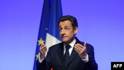 President Sarkozy announcing France's return to the NATO inner circle in Paris on March 11.
