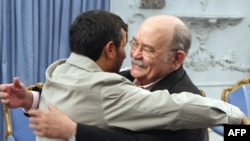 Iranian President Mahmud Ahmadinejad (left) welcomes the president of the UN General Assembly, Miguel d'Escoto Brockmann, in Tehran on March 9.
