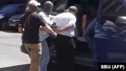 Кадр із відео СБУ про затримання підозрюваного в організації замаху на Аркадія Бабченка