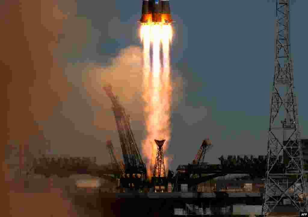 Qazaxıstanın Baikonur KosmodromundanSoyuz raketi kosmosa buraxılarkən / Foto:AFP