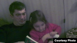 Marat Gunashev, seen here with his daughter in an undated family photo, has been held in detention since being apprehended on November 28 in the operating theater of the Makhachkala hospital where he worked.