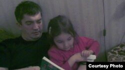Daghestan anesthesiologist Marat Gunashev (with daughter) in an undated photo obtained in January 2013