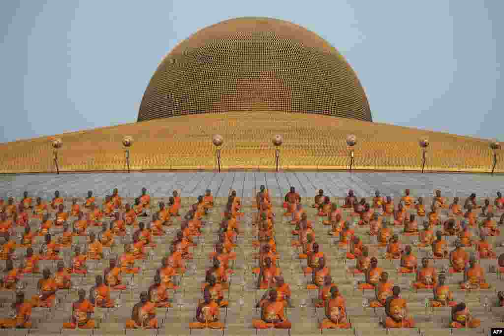 Buddhist monks meditate during a ceremony at the Dhammakaya Temple in Bangkok, Thailand. (AFP/Nicolas Asfouri)