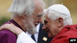 Britain's archbishop of Canterbury, Rowan Williams (left), greets Pope Benedict XVI at Lambeth Palace in central London