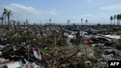 A general view of flattened houses along the coastal area in Tacloban, on the eastern island of Leyte, on November 10, 2013, after Typhoon Haiyan swept over the Philippines.