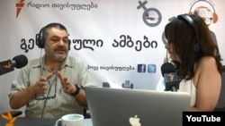 """Gender Stories"" host Marina Vashakmadze discusses sexism with a guest. Georgia, June 18, 2014."