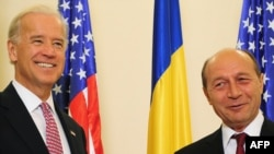 Romanian President Traian Basescu (right) says the topic came up during an October visit by U.S. Vice President Joe Biden.