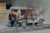 A police vehicle burns following the violence (RFE/RL)