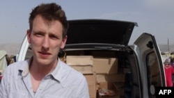 A family handout photo of American Kassig, who became an aid worker and later converted to Islam, prior to his capture by militants in Syria in 2013