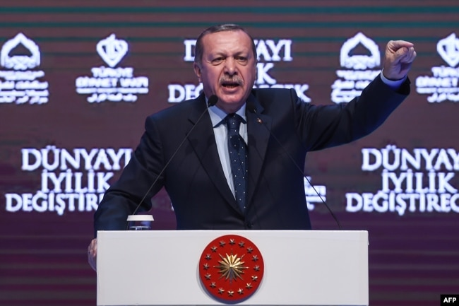 Turkish President Recep Tayyip Erdogan gestures as he addresses supporters in Istanbul on March 12.