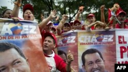 Supporters of ailing Venezuelan President Hugo Chavez rally outside the presidential palace in Caracas on January 10.