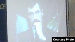 Фотография Евгения Жовтиса на телевизионном экране в зале заседания конференции «35 лет Хельсинкского движения: прош¬лое, настоящее, будущее». Москва, 12 мая 2011 года.