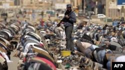 Rebel guards perform Friday Prayers in Benghazi.