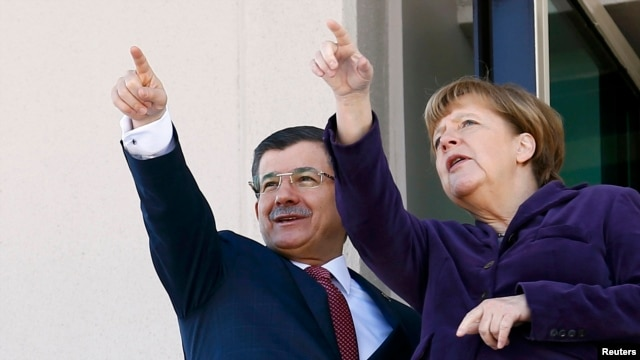 Turkish Prime Minister Ahmet Davutoglu (left) and German Chancellor Angela Merkel in Ankara on February 8