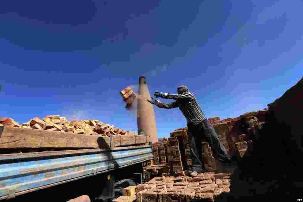 An Afghan man works at a brick kiln in Herat. (epa/Jalil Rezayee)