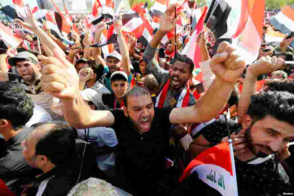 Supporters of Iraqi Shi'ite cleric Moqtada al-Sadr shout slogans during a protest against corruption on Tahrir Square in Baghdad on July 15. (Reuters/Khalid al-Mousily)