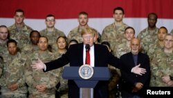 U.S. President Donald Trump delivers remarks to U.S. troops during an unannounced visit to Bagram Air Base near Kabul on November 28, 2019.