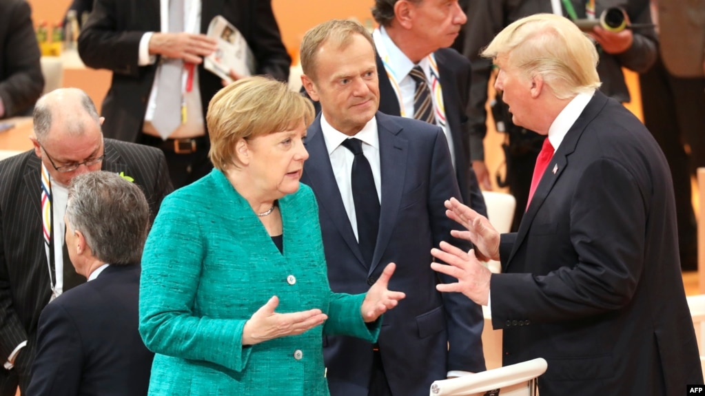 German Chancellor Angela Merkel (left to right), European Council President Donald Tusk, and U.S. President Donald Trump joke at the beginning of the third working session of the G20 meeting in Hamburg on July 8.
