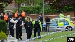 На месте преступления в районе Вулвич на юго-востоке Лондона, 22 мая 2012 г.