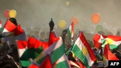Iraqi Kurds fly Kurdish flags during an event to urge people to vote in the upcoming independence referendum in Arbil, the capital of the autonomous Kurdish region of northern Iraq, on September 15, 2017.