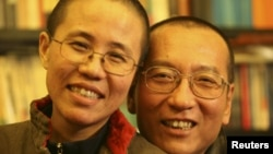 Chinese dissident Liu Xiaobo (right) and his wife Liu Xia pose in a photo released by his family.