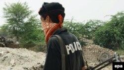 Сотрудник сил безопасности Пакистана в провинции Хайбер-Пахтунхва.