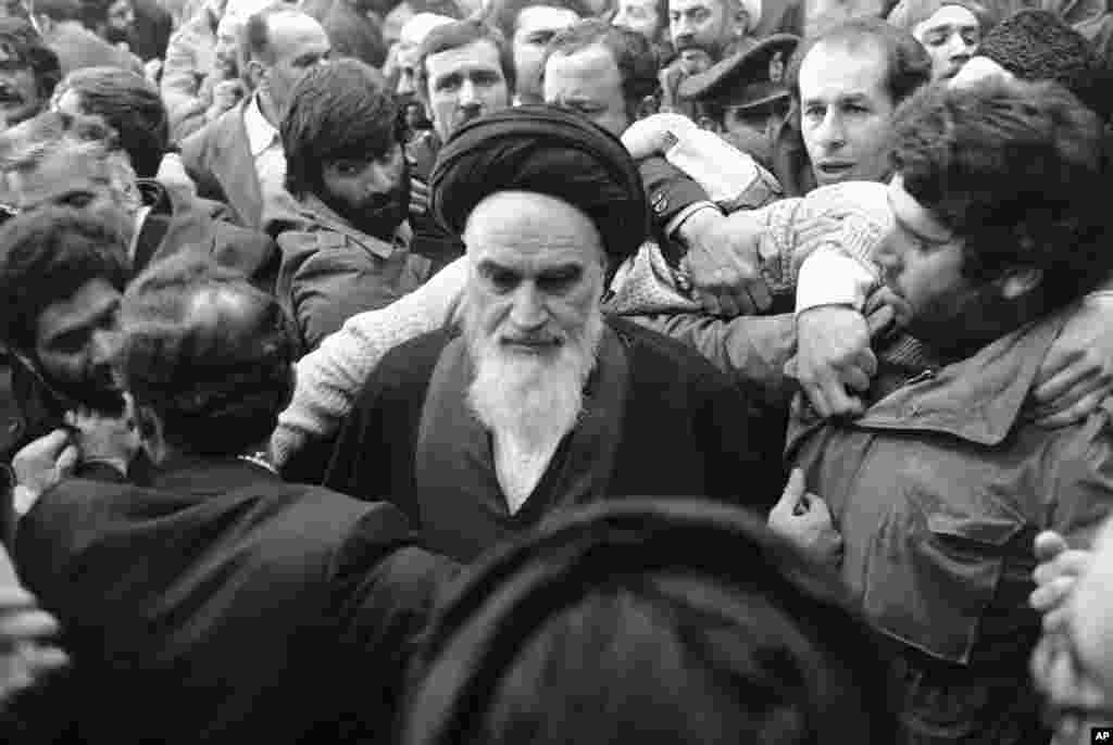 Khomeini is thronged by his supporters at Tehran's airport.