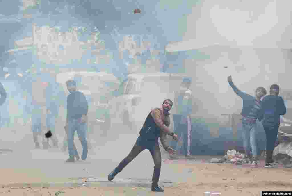 Demonstrators throw stones toward police in Seelampur on December 17.