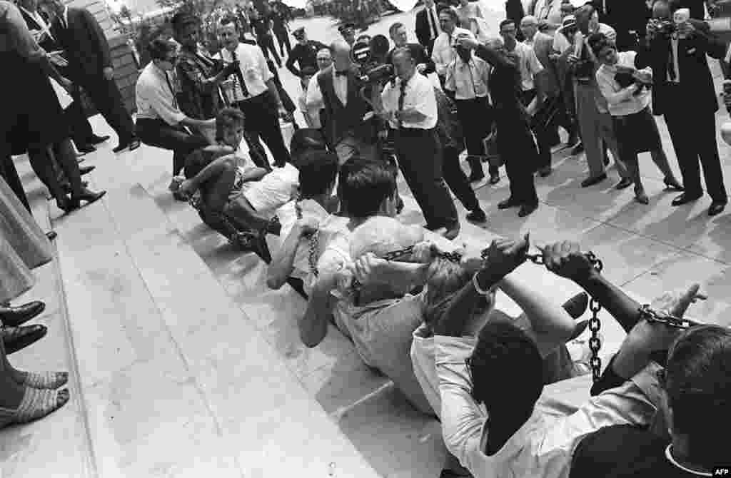 Black and white protesters chain themselves together during a protest against segregation in front of New York City Hall on August 23, 1963.