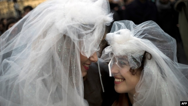Two women in wedding veils in front of Notre-Dame Cathedral in Paris during a demonstration in December for the legalization of gay marriage and LGBT (lesbian, gay, bisexual, and transgender) parenting.