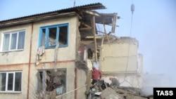 Rescue workers at the blast site in the village of Vozdvizhenka