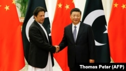 Chinese President Xi Jinping (right) shakes hands with Pakistani Prime Minister Imran Khan in Beijing on November 2.