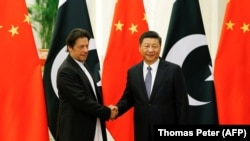 FILE: Chinese President Xi Jinping meets with Pakistani Prime Minister Imran Khan at the Great Hall of the People in Beijing in November 2018.