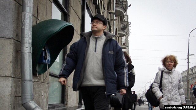 Ales Mikhalevich walks to KGB offices in Minsk for questioning in March, three months after his challenge in the tainted Belarusian presidential election.