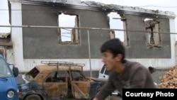 A burned down house in Tashlak, a village outside Osh.