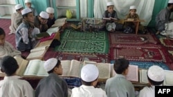 Afghan boys read the Koran at a madrasah in Ghazni Province. President Ghani has stressed that the Koran and Islamic Shari'a law should be the basis of the ongoing peace talks between the government and the Taliban. (file photo)
