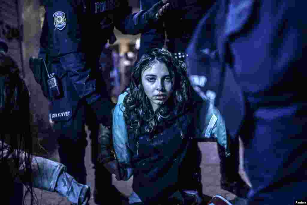 Bulent Kilic, a Turkish photographer for Agence France-Presse, won First Prize in the Spot News Category, Singles, with this picture of a young girl after she was wounded during clashes between riot police and protesters following the funeral of Berkin Elvan, an 15-year-old boy who died from injuries suffered during antigovernment protests in Istanbul.