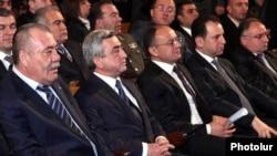 Armenia - President Serzh Sarkisian (second from left) and General Manvel Grigorian (L) attend a congress of the Yerkrapah Union of Nagorno-Karabakg war veterans in Yerevan, 18Feb2012.