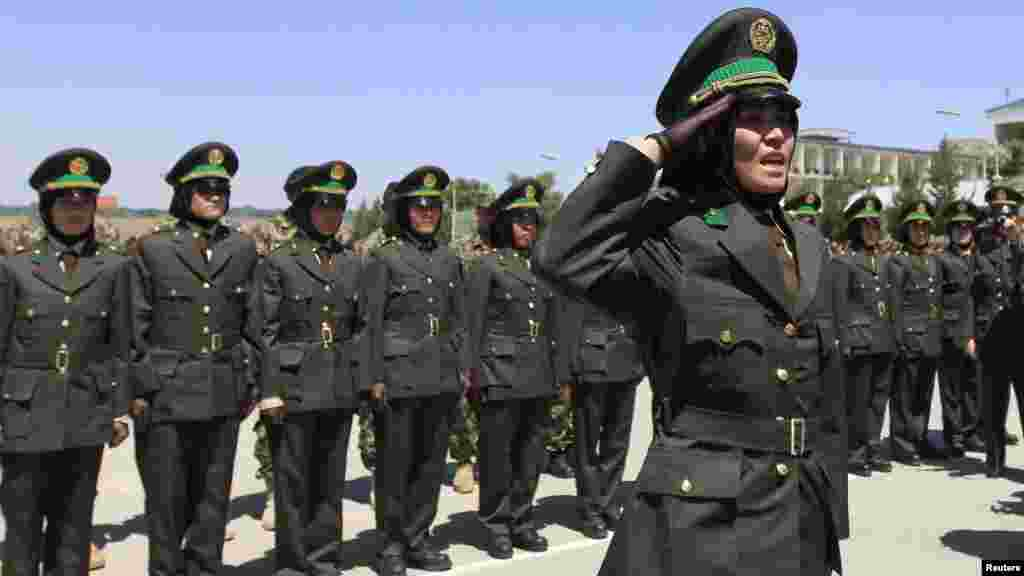 An Afghan female officer salutes during a graduation ceremony at the Kabul Military Training Center. (Reuters/Mohammad Ismail)