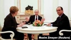 Переговоры Ангелы Меркель, Владимира Путина и Франсуа Олланда (слева направо) по урегулированию украинского кризиса. Кремль, 6 февраля 2015 года.