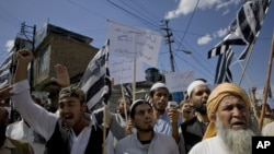 Supporters of the Jamiat Ulema-e-Islam chant slogans during an anti-U.S. rally in Abbottabad in May 2011