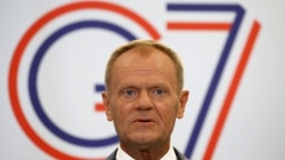 European Council President Donald Tusk speaks during a news conference on the sidelines of the G7 summit on August 24.
